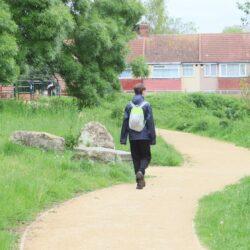 boy walking in park