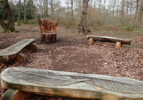 Carved benches on the heath